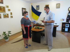 Мешканка села Берег отримала почесну нагороду